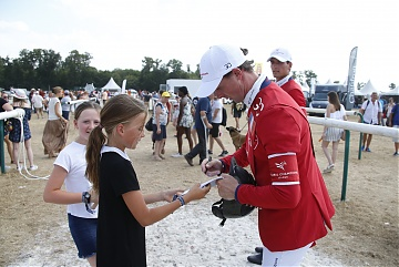 Ben Maher signs autographs to his fans