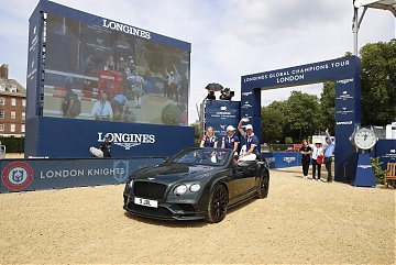 Team London Knights riders Ben Maher, Emily Moffitt and Nicola Philippaerts enter the arena aboard an elegant Bentley Supersports GTC