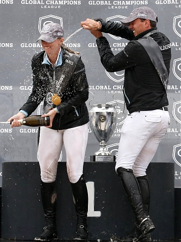 GCL of Paris - Champagne celebration - Harrie Smolders and Audrey Coulter celebrate after winning the GCL of Paris
