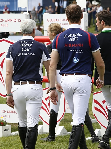 Team Chantilly Pegasus' Roger Yves Bost (FRA) and Team Scandinavian Vikings Christian Ahlmann (GER)